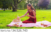 happy woman with smartphone on picnic at park. Стоковое видео, видеограф Syda Productions / Фотобанк Лори