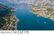Flying above the old town of Kotor in Montenegro in the Bay of Kotor. Стоковое фото, фотограф Игорь Соловьев / Фотобанк Лори