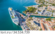 Flying above the old town of Kotor in Montenegro in the Bay of Kotor. Редакционное фото, фотограф Игорь Соловьев / Фотобанк Лори
