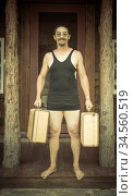 Goofy Gentleman Dressed in 1920?s Era Swimsuit Holding Suitcases ... Стоковое фото, фотограф Zoonar.com/Andy Dean Photography / age Fotostock / Фотобанк Лори
