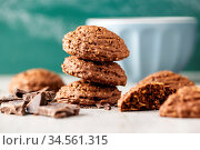 Cereal cocoa cookies on old kitchen table. Стоковое фото, фотограф Zoonar.com/JIRI HERA / easy Fotostock / Фотобанк Лори