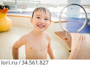 Mixed Race Boy Having Fun at the Water Park with Large Rubber Duck... Стоковое фото, фотограф Zoonar.com/Andy Dean Photography / age Fotostock / Фотобанк Лори