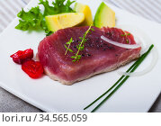 Delicious raw tuna fish served with fresh avocado and greens. Стоковое фото, фотограф Яков Филимонов / Фотобанк Лори