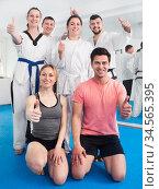 Adults happy to attend karate class. Стоковое фото, фотограф Яков Филимонов / Фотобанк Лори