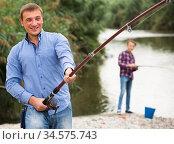 man casting line for fishing on river . Стоковое фото, фотограф Яков Филимонов / Фотобанк Лори