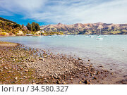 Beach and water in the French settlement of Akaroa on Banks Peninsula... Стоковое фото, фотограф Zoonar.com/Chris Putnam / easy Fotostock / Фотобанк Лори