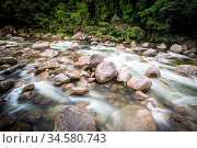 Water of the Mossman River flows over ancient rocks and boulders in... Стоковое фото, фотограф Zoonar.com/Chris Putnam / easy Fotostock / Фотобанк Лори