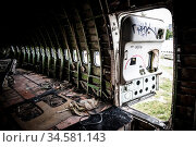 The interior of a derelict, vandalised aircraft in Bangkok, Thailand. Стоковое фото, фотограф Zoonar.com/Chris Putnam / easy Fotostock / Фотобанк Лори