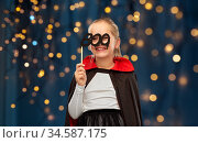 girl in costume of dracula with cape on halloween. Стоковое фото, фотограф Syda Productions / Фотобанк Лори