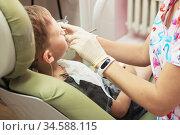 A little boy at a dentist's reception in a dental clinic. Children's dentistry, Pediatric Dentistry. Стоковое фото, фотограф Nataliia Zhekova / Фотобанк Лори
