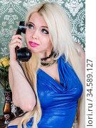 Lovely woman in blue dress talking on the phone. Retro portrait. Стоковое фото, фотограф Zoonar.com/Figurniy Sergey / age Fotostock / Фотобанк Лори