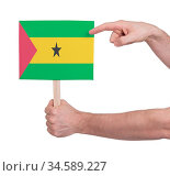 Hand holding small card, isolated on white - Flag of Sao Tome and... Стоковое фото, фотограф Zoonar.com/Micha Klootwijk / age Fotostock / Фотобанк Лори