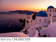 Sunset at the Island Of Santorini Greece, beautiful whitewashed village... Стоковое фото, фотограф Zoonar.com/Fokke Baarssen / age Fotostock / Фотобанк Лори
