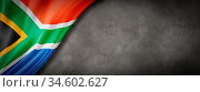 South Africa flag on concrete wall. Horizontal panoramic banner. ... Стоковое фото, фотограф Zoonar.com/Laurent Davoust / age Fotostock / Фотобанк Лори