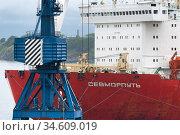 Russian cargo container ship nuclear-powered icebreaker Sevmorput Corporation Atomflot or Rosatomflot. Container terminal commercial seaport. Pacific Ocean (2019 год). Редакционное фото, фотограф А. А. Пирагис / Фотобанк Лори