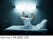 Psycho man alone in bed, dark room, hospital. Стоковое фото, фотограф Tryapitsyn Sergiy / Фотобанк Лори