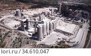 Aerial view of a huge cement plant with warehouses in Bunol, Valencia, Spain (2019 год). Редакционное видео, видеограф Яков Филимонов / Фотобанк Лори
