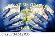 Sweaty girl covered her breast with money (dollars), flag of Oregon. Стоковое фото, фотограф Zoonar.com/Micha Klootwijk / age Fotostock / Фотобанк Лори
