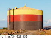Colorful storage tank in the south of Iceland. Стоковое фото, фотограф Zoonar.com/Micha Klootwijk / age Fotostock / Фотобанк Лори