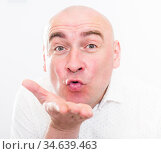 portrait of bald adult mature man with emotions on white background. Стоковое фото, фотограф Татьяна Яцевич / Фотобанк Лори