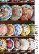 Beautiful Hand Painted Turkish Plates on Shelf at Market. Стоковое фото, фотограф Zoonar.com/Andy Dean Photography / age Fotostock / Фотобанк Лори