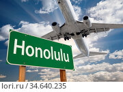 Honolulu Green Road Sign and Airplane Above with Dramatic Blue Sky... Стоковое фото, фотограф Zoonar.com/Andy Dean Photography / age Fotostock / Фотобанк Лори