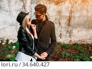 Photo of a young beautiful couple on the background of the old wall. Стоковое фото, фотограф Zoonar.com/Oleksii Hrecheniuk / age Fotostock / Фотобанк Лори