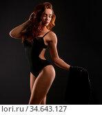 Studio image of sexy underwear model posing in high heels. Стоковое фото, фотограф Zoonar.com/Andrey Guryanov / easy Fotostock / Фотобанк Лори