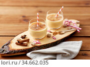 glasses of eggnog, ingredients and spices on wood. Стоковое фото, фотограф Syda Productions / Фотобанк Лори