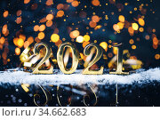 Christmas year from golden numbers with gold sparkle bokeh abstract background. Стоковое фото, фотограф Евдокимов Максим / Фотобанк Лори