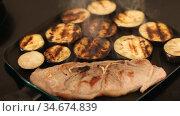 Process of frying of pork shoulder chop with sliced aubergines on fry pan. Стоковое видео, видеограф Яков Филимонов / Фотобанк Лори