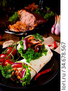 Tasty wraps filled with pulled pork and salad. Стоковое фото, фотограф Zoonar.com/Darius Dzinnik / easy Fotostock / Фотобанк Лори