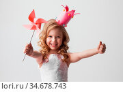 Beautiful little candy princess girl in crown holding pinwheel and... Стоковое фото, фотограф Zoonar.com/Ivan Mikhaylov / easy Fotostock / Фотобанк Лори