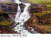 Powerful streams of cascade falls with a roar break against cold rocks... Стоковое фото, фотограф Zoonar.com/kavram / easy Fotostock / Фотобанк Лори