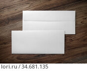 Two blank envelopes on wooden background. Front and back side. Flat... Стоковое фото, фотограф Zoonar.com/Alex Veresovich / easy Fotostock / Фотобанк Лори