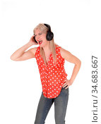 A beautiful middle age woman standing with her headphones and singing... Стоковое фото, фотограф Zoonar.com/Horst Petzold / easy Fotostock / Фотобанк Лори