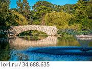 Old stone bridge in victoria british columbia park. Стоковое фото, фотограф Zoonar.com/Alex Grichenko / age Fotostock / Фотобанк Лори