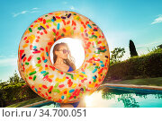 Calm girl in sunglasses and inflatable doughnut. Стоковое фото, фотограф Сергей Новиков / Фотобанк Лори