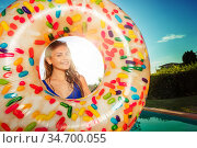 Smiling girl with inflatable doughnut portrait. Стоковое фото, фотограф Сергей Новиков / Фотобанк Лори