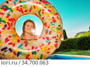 Girl in yellow bikini with inflatable doughnut. Стоковое фото, фотограф Сергей Новиков / Фотобанк Лори