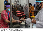 Catholic devotees attend the first mass prayers since a partial lockdown... Стоковое фото, фотограф Aditya Saputra / INA Photo Agency / age Fotostock / Фотобанк Лори