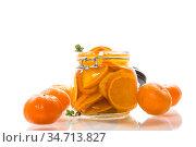 tangerine jam in a glass jar isolated on white background. Стоковое фото, фотограф Peredniankina / Фотобанк Лори