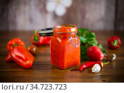 fresh natural homemade sauce made of peppers, tomatoes and other vegetables. Стоковое фото, фотограф Peredniankina / Фотобанк Лори