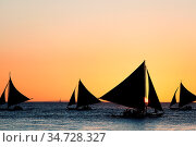 Sailing boats silhouette at orange sunset background. Стоковое фото, фотограф Zoonar.com/Ivan Mikhaylov / easy Fotostock / Фотобанк Лори