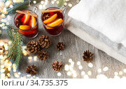 mulled wine with orange and spices, cones and fir. Стоковое фото, фотограф Syda Productions / Фотобанк Лори