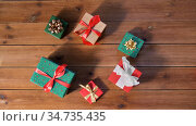christmas gifts on wooden boards. Стоковое фото, фотограф Syda Productions / Фотобанк Лори