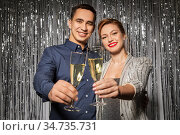 happy couple toasting champagne glasses at party. Стоковое фото, фотограф Syda Productions / Фотобанк Лори
