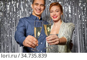 couple with champagne glasses at christmas party. Стоковое фото, фотограф Syda Productions / Фотобанк Лори