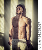 Portrait of sexy shirtless man covered with shadow stripes from window. Стоковое фото, фотограф Zoonar.com/Stefano Cavoretto / easy Fotostock / Фотобанк Лори