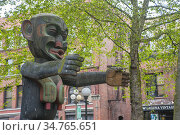 The fearsome Tsonogua pole (1980s) by Duane Pasco in Occidental Park... Стоковое фото, фотограф Wolfgang Kaehler / age Fotostock / Фотобанк Лори